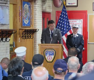 Fire Commissioner Daniel Nigro salutes Ladder 81 on its 100th anniversary. Photo: Sam Villalobos.