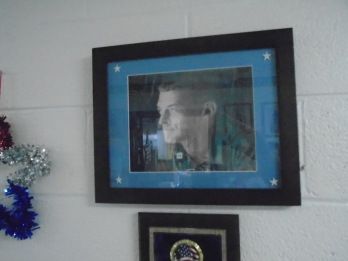 A portrait of Sgt. Michael Ollis by Staten Island artist Gabriel Arout graces the halls of St. Adalbert's School in Elm Park, Staten Island. Photo by Meredith Arout for Life-Wire News Service. Memorial Day, May 25, 2015.