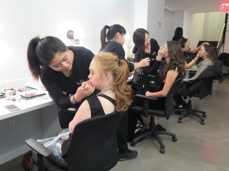 Madeline Stuart (foreground) and Shaholly Ayers in make-up.