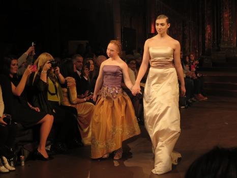 Madeline Stuart (left) walks the runway with Caroline Rose.