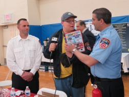 Reporter Anthony Pabon interviews the FDNY. Photo by Raheim Gladden for Life-Wire News Service.
