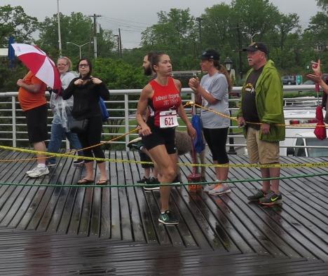 Women's race winner Olga Kosichenko, approaching the finish line. Photo: Adriana Kolari for Life-Wire News Service.
