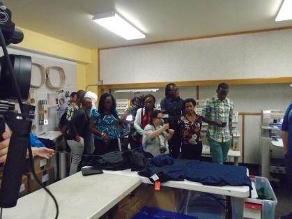 The Mandela Washington Fellows tour TeeStyles embroidery shop. Photo: Jake for Life-Wire News Service.